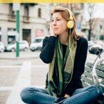girl listening to music with yellow headphones