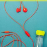 music-vitamins-red-earbuds-water-bottle-cell-phone